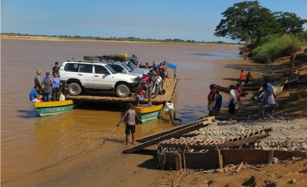 Madagascar-crossing-river-four-wheel-drives-via-barge