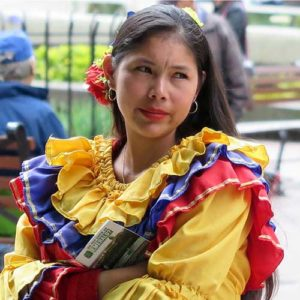 Colourful dress worn by Colombian young woman