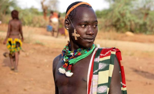Hamar tribesman wearing ornate beads around his neck