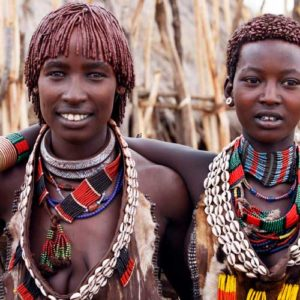 Two tribes women decorated with beads and shells
