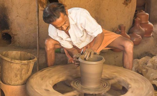 India-man-making-pottery