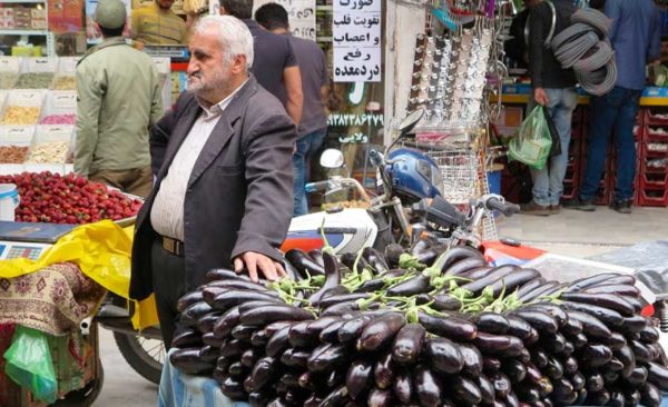 Iran-man-selling-eggplants