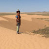 Mongolia-gobi-desert-little-boy-camel-hearder