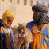 Meet goat herders holding their goats on your Morocco tours