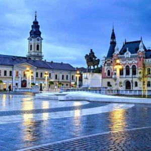 Beautiful buildings of union square oradea at dusk