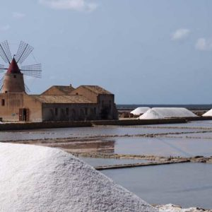 Salt pans drying in the sun and mounds of salt