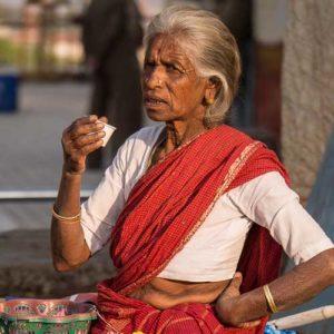 Older Sri Lankan lady drinking tea