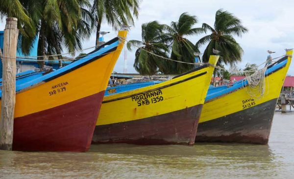 Three colourful old fishing boats