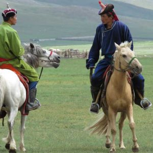 Mongolian men on horseback at Naadam