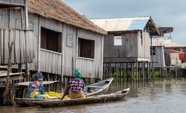 Women-on-boats-going-to-market-Benin-lake